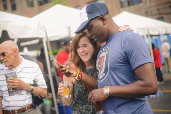 couple enjoying beer tasting at festival